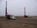 Drilling piles